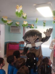 Preschool children get a chance to give Josh, the Otter,