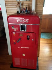 Two new additions for the reopening of the barbershop include this 1950s working Coca-Cola drink dispenser.