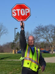 Battle Creek crossing guard Merle Boyer, 65, returned to work Monday after he was struck by a vehicle in March.