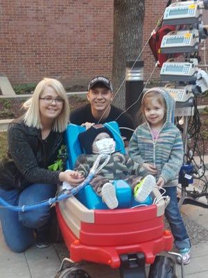 Akasha, Tim, Lilliona and Jace Josephson walk outside the Mayo Clinic Hospital, Saint Marys Campus, on Sunday, April 22.