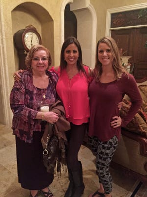 Radio talk show host Lillian McDermott, center, with her mom and one of her daughters.