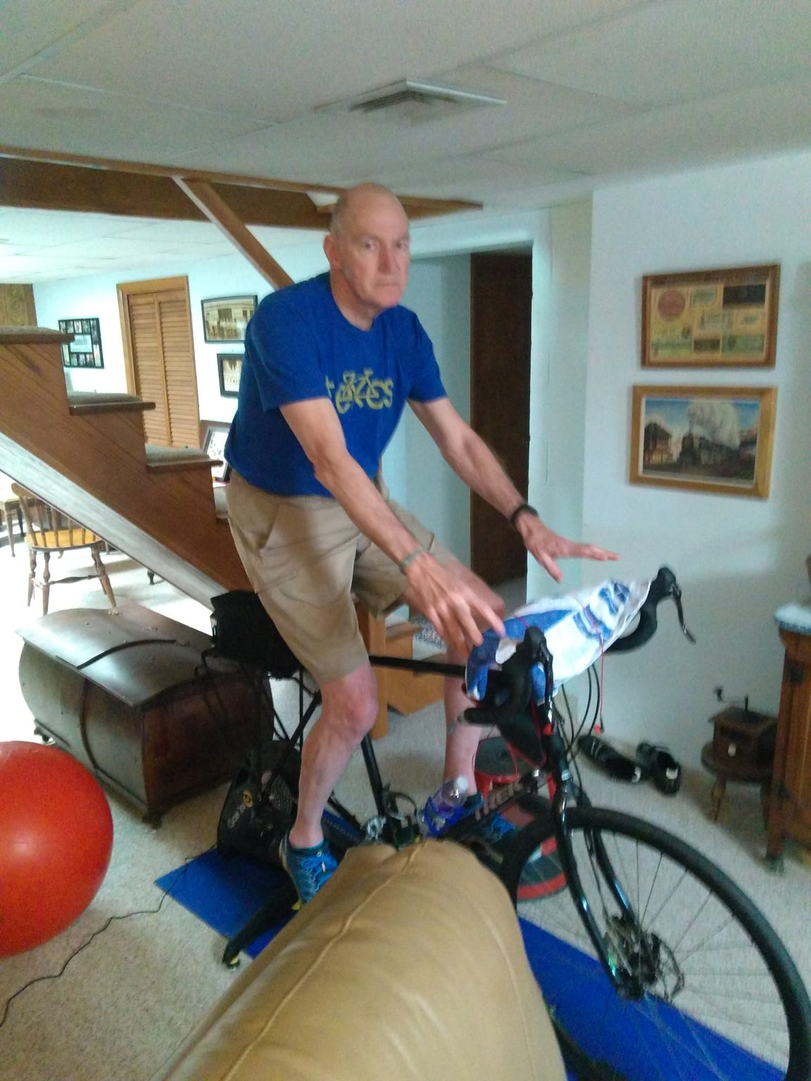 Tom Bay rides a stationary bike in his home in an attempt