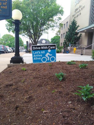 "The Lebanon Valley Bicycle Coalition is holding a ""Drive With Care"" campaign, featuring signs like this one in front of the Lebanon County courthouse."
