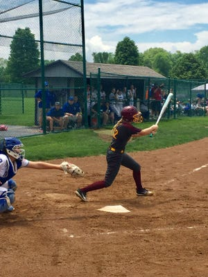 Berne Union senior Paige Probasco hits a single during the Rockets Division IV district final loss to Danville on Saturday at Pickerington Central.