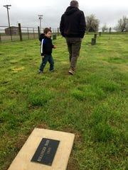 Dennis Nottinghamand Henry, 4, walk through the Carter