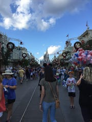 The crowds wear their Mickey Mouse ears on Main Street in Walt Disney World's Magic Kingdom.