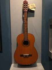 Charles Manson's guitar sits on display as a new artifact in the museum's collection.