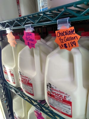 Cartons of Harrisburg Dairies milk sit in a refrigerator at Sunset Grocery Outlet at 1650 N. 7th St.