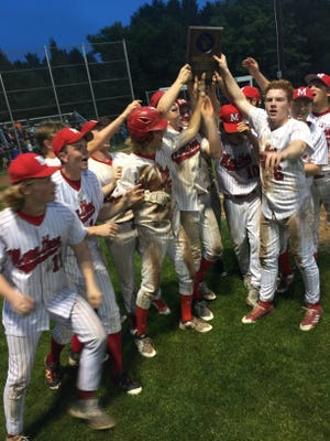 Members of the Marathon baseball team hoist the WIAA Division 3 regional title plaque after a 3-2 win over Stratford in eight innings Wednesday, May 30, 2018.