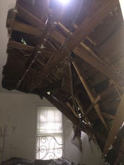 Jules Hamilton and her roommate Jocelyn Ellis cannot go back to their downtown apartment after a tree fell through Hamilton's bedroom ceiling Monday.
