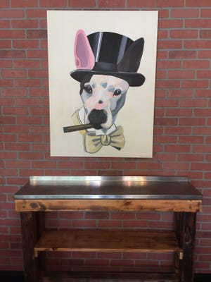 Artist and art therapist Antonia Cianfrani, who does professional pet portraits, created this painting of Peter James, the beloved pitbull of Silver Spoon owners Jillian and Dennis Kelley. The catering company will begin offering a pop-up restaurant in Westmont called Silver Spoon Presents Peter James. To know when it's open, guests can follow Silver Spoon on Instagram or watch for the Peter James sign to appear out front.