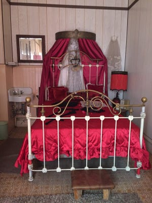 A restored bedroom in the Dumas Brothel Museum in Butte gives visitors an idea what the last house of prostitution in Montana was like before its 1982 closure.