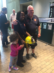 Station 4 firefighter Kevin Sheppard welcomes volunteer firefighter Elizabeth Daugherty after her swearing-in June 12 at Vineland City Hall. Also pictured is Daugherty's daughter, Madison.
