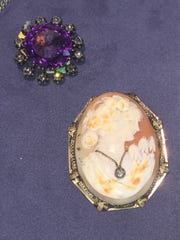 A Victorian amethyst and diamond brooch and a cameo
