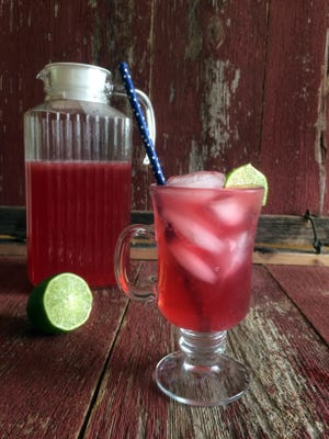 Hibiscus tea blends with lime juice in this pretty summer refresher.