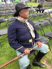 C.F. Brown, a member of the Buffalo Soldiers Mounted Calvary Unit, takes a break prior to opening ceremonies at the 2018 Juneteenth celebration at Plaza Park in downtown Oxnard.