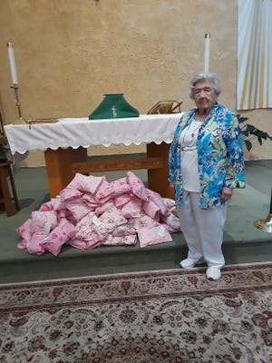 Maryalice Robinson is pictured with the more than 70 Breast Cancer Comfort Pillows sewed by the Women of the Church of the Resurrection (Episcopal), which were donated to the Breast Cancer Bridge Program at Inspira Health Network. For information, call (609) 319-9234 or visit https://cumberlandnjepiscopal.org.