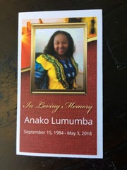 Anako Lumumba's prayer card, which was given out at