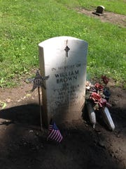 A memorial stone marker for Sgt. William Brown, the first of two recipients of the Badge of Military Merit, the precursor of the Purple Heart, during the Revolutionary War, stands in Pioneer Cemetery in Columbia Tusculum.