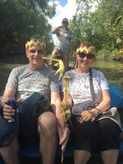 Tim and Mary Callahan take a ride on the Mekong Delta