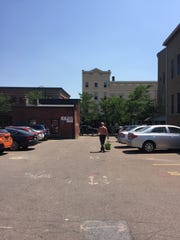 A naked man who declined to identify himself was spotted making several loops around downtown Burlington on Thursday, July 5, 2018. After a Free Press journalist asked to take his picture and followed him attempting to do so, he disappeared behind some cars on the 190 block of College Street and emerged wearing pants.