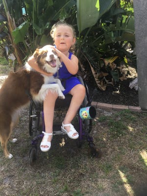 Hannah Ahlquist with her service dog, Sadie.