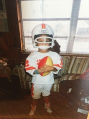 Tiffany Greene is a lifelong Tampa Bay Bucs fans. Here she is as a small child sporting the creamsicle uniform.
