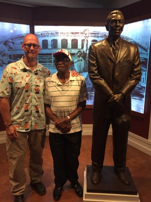 Jeff Klein, left, and Negro League legend Bill McCrary at Cooperstown. The friends made a pilgrimage to Baseball Hall of Fame to see Buck O'Neil's statue. O'Neil was McCrary's former manager.