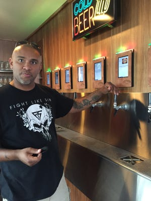 Brandon Reed, owner of the Cozy Tavern, talks about the bar's self serving tap system, where patrons may pour their own beer by the ounce.