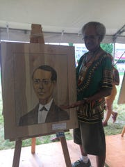 William Harrell displays his portrait of Ezekiel Gillespie,