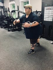 Gary working out on the functional trainer.