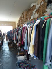 Racks of women's clothes at the Hope Project warehouse.