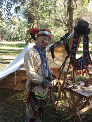 """Provided is a photo of of a Seminole re-enactor taken during a past Fall Muster of  Loxahatchee Battlefield Preservationists, a nonprofit group dedicated to education and preservation. During a """"Day of Living History"""" at Loxahatchee River Battlefield Park in Jupiter, Seminole and soldier re-enactors told the history of the times, and gave weapons and artillery demonstrations"""