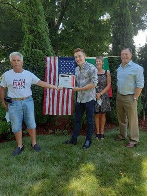 Steve Eosco, lodge president; Stephen Ailinger, scholarship recipient; and his parents, Amy and Joseph Ailinger