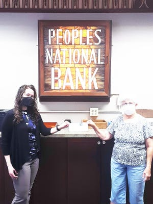 Sandy Hill (right), representing the Kewanee Food Pantry, accepts a $100 donation from Peoples National Bank employee Lea Eastman, who recently walked over 286,000 steps in a week to win the final round of the PNB Wellness Program Challenge: Summer Health Madness Tournament. She chose the food pantry as recipient for the charity portion of her prize.