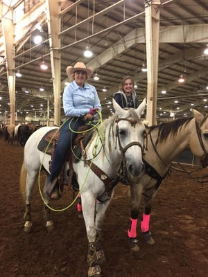 Kyla Stamps, 17,  left, shown with her sister Kenzie, 12, is back in the rodeo ring after having multiple blood clots travel from her leg, which was in a cast at the time, to her lungs. Before her surgery and the clots, she had been first in the all-girl category for United States Team Roping Championships.