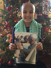 Gracie West of Freehold Township holds a photo of her and Pope Francis in her home.