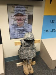 Jimmy Hansen's gear sits in front of the Airman's Creed, which also features Hansen's image in the background. It was part of the room dedication for Hansen at Keesler Air Force Base in Biloxi, Miss., where he had been stationed.