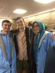 Somerset County guys Steve Raynes, Will Lacosta and Alex Mango (left to right) hang out after Columbia's victory over Brown in men's swimming.