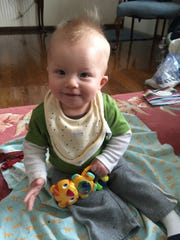 Jackson Lange, 8 months, was diagnosed in utereo with