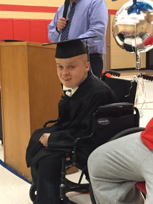 Seth Miller, 19, received his high school diplomas from both Wynford and Angeline schools Friday. He has been diagnosed with stage 4 kidney failure and given only about six months to live.