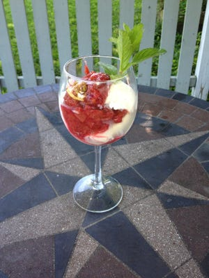 Homemade rhubarb sauce makes a tart-sweet topping for a spring vanilla ice cream parfait.