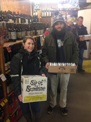 Heather Hamlin, left, and Nicholai L'Esperance of Milton were first in line for a Heady Topper and Lawson's Sip of Sunshine release at Beverage Warehouse of Vermont in Winooski in November 2014.