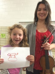 Madison Elementary School third-grader Marissa Webster drew a pig named Oinky to represent the sound of the violin played by Charlene Kluegel, a member of Chicago's Fifth House Ensemble.