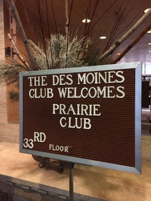 A sign greets members of the Des Moines Prairie Club in the lobby of the Ruan Center downtown.