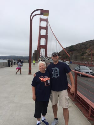 Margaret McConaghie from Sterling Heights visits her son Robert McConaghie in September at the Golden Gate Bridge. Robert now lives in San Jose, but still shows off the Old English D.