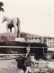 """This is a 1965 photo showing the """"American Girl"""" statue at Eldridge Park in Elmira."""