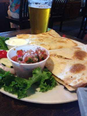 The chicken quesadilla features a mixture of provolone and cheddar cheeses along with roasted red peppers.