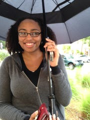 """""""The umbrella is for the phones. It's not for me,"""" said Thai Lynn, 22, of Estero, who bought herself and her dad iPhone 6 models at AT&T and stood in line at the Coconut Point Apple store to buy her mom an iPhone 6 Plus because she likes a bigger screen."""