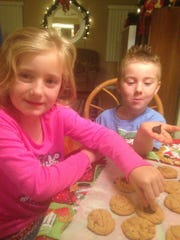 Chris King's grandchildren Hannah and Noah with their honorable-mention cookies.